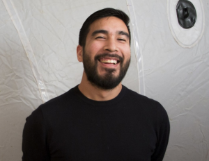 Alejandro T. Acierto laughing in front of his inflatable sculptural work