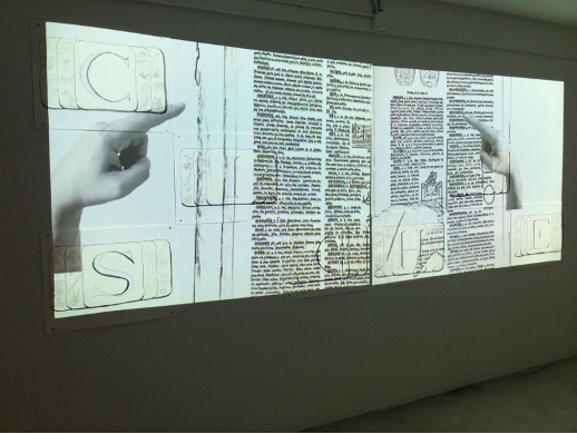 White Code: C.I.T.E./S.I.T.E./S.I.G.H.T. (2013), mixed media drawings, dimensions varied, and two-channel video projection, silent, black and white, looped